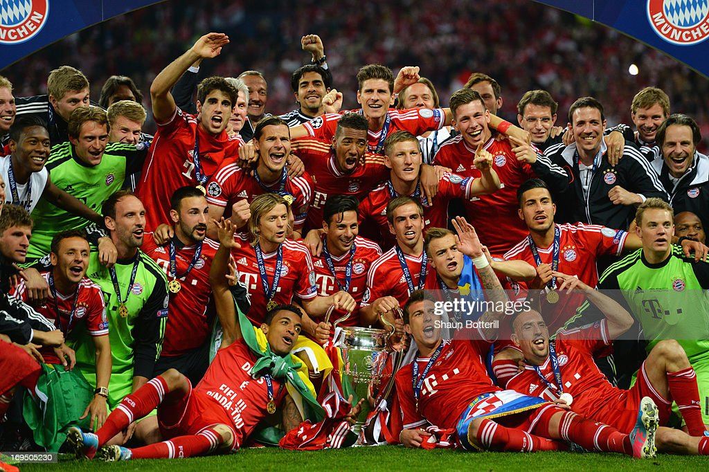 Bayern Muenchen Players Celebrate Victory With The Trophy