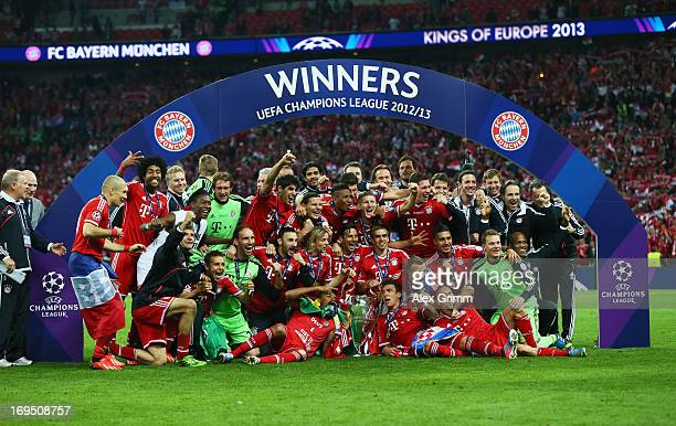 Bayern Muenchen players celebrate victory with the trophy after the UEFA Champions League final match between Borussia Dortmund and FC Bayern...