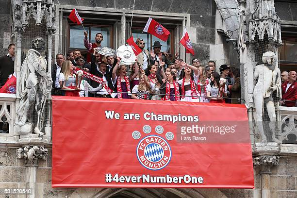 Bayern Muenchen players celebrate winning the Bundesliga at Marienplatz on May 15 2016 in Munich Germany