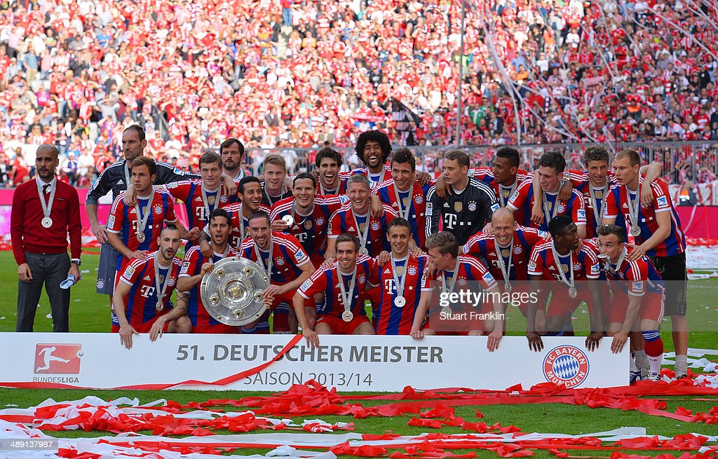 Bayern Muenchen players celebrate with the Bundesliga championship trophy after the Bundesliga match between Bayern Muenchen and VfB Stuttgart at Allianz Arena on May 10, 2014 in Munich, Germany.