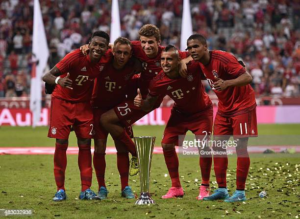 Bayern Muenchen players David Alaba Rafinha Thomas Mueller Arturo Vidal and Douglas Costa celebrate after the Audi Cup 2015 Final between FC Bayern...