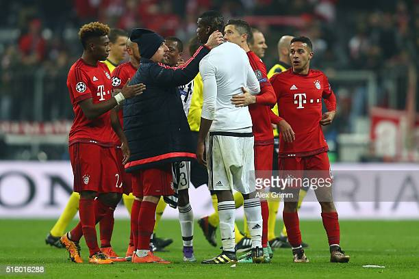 Bayern Muenchen players including Franck Ribery and Robert Lewandowski console Paul Pogba of Juventus after the UEFA Champions League round of 16...