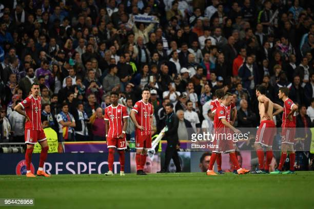 Bayern Muenchen players show dejection after the UEFA Champions League Semi Final Second Leg match between Real Madrid and Bayern Muenchen at the...