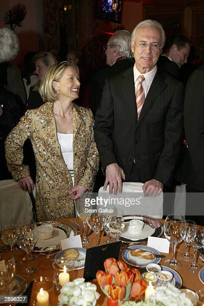 Bayern Muenchen president Franz Beckenbauer and Heidrun Burmester attend the Audi Evening at Hotel Tenne during the Hahnenkamm Ski Races January 23...