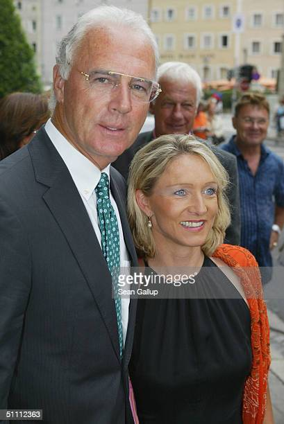 Bayern Muenchen president Franz Beckenbauer and his wife Heidrun Burmester arrive for the first performance of Jedermann at the 2004 Salzburg Music...