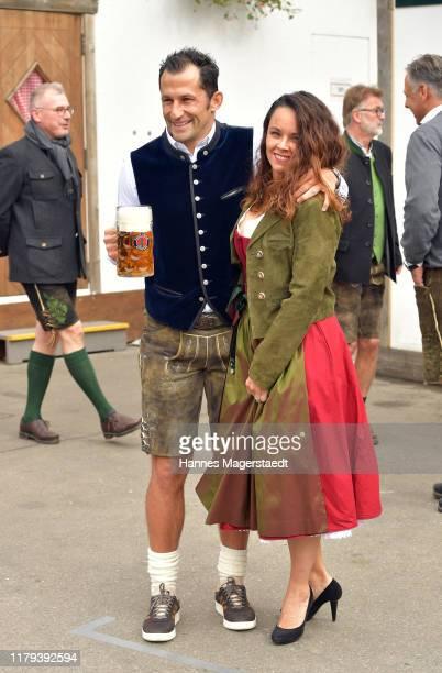 Bayern Muenchen sporting director Hasan Salihamidzic and his wife Esther Copado attend the Oktoberfest at Kaefer Wiesenschaenke tent at...