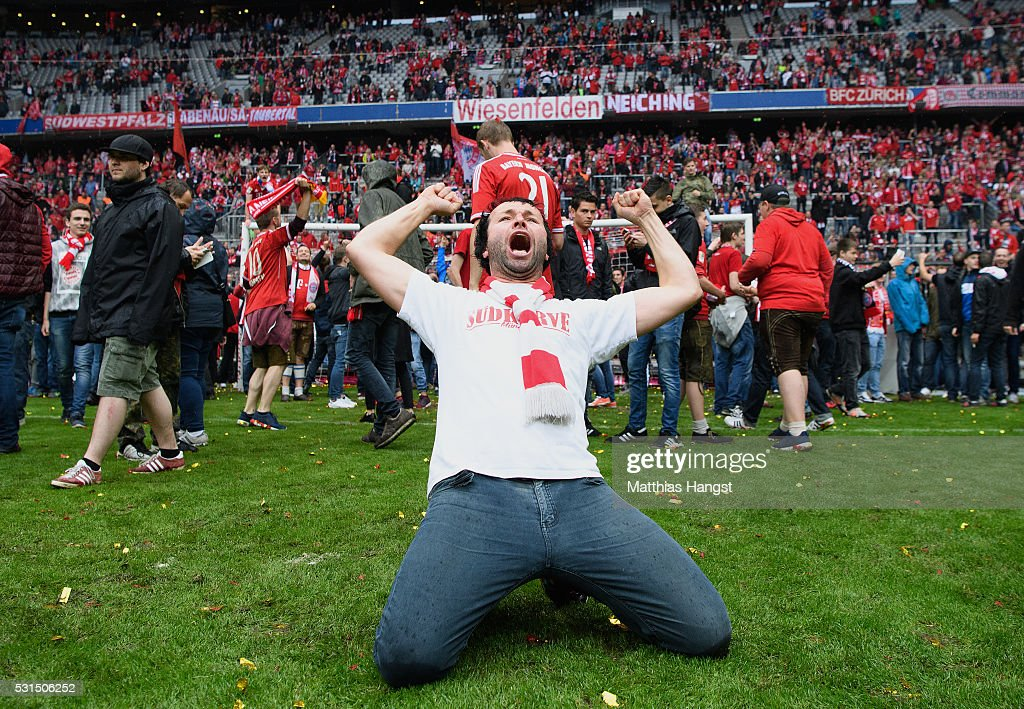 A Bayern Muenchen supporter celebrates the Bundesliga champions after the Bundesliga match between FC Bayern Muenchen and Hannover 96 at Allianz Arena on May 14, 2016 in Munich, Germany.