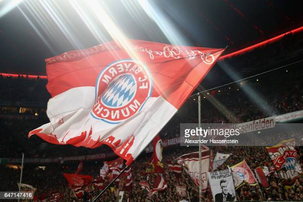 Bayern Muenchen supportes wave flags prior to the DFB Cup quarter final between Bayern Muenchen and FC Schalke 04 at Allianz Arena on March 1 2017 in...