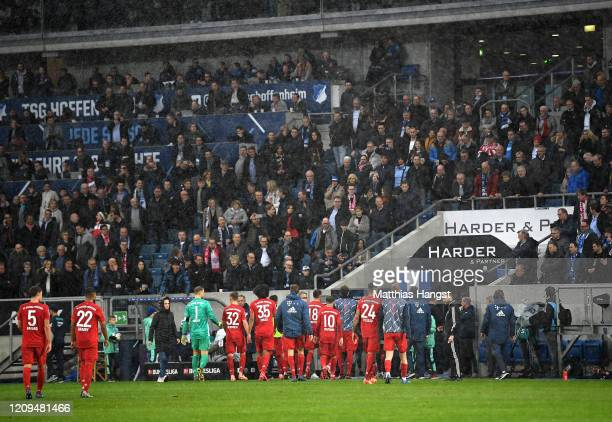 Bayern Muenchen team walk back to the changing rooms following demonstrations from the stands during the Bundesliga match between TSG 1899 Hoffenheim...
