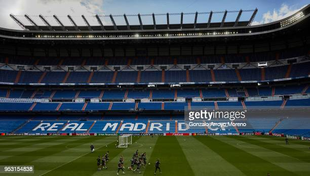 Bayern Muenchen team warm up during a training session held ahead of the UEFA Champions League semifinal second league match between Real Madrid CF...