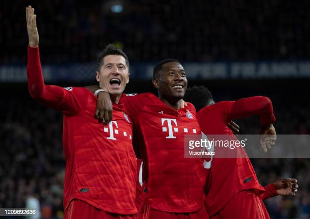 Bayern Munchen players Robert Lewandowski David Alaba and Alphonso Davies celebrate the third goal during the UEFA Champions League round of 16 first...