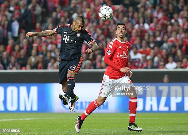 Bayern Munchen's midfielder from Chile Arturo Vidal with SL Benfica's defender Andre Almeida in action during the UEFA Champions League Quarter Final...