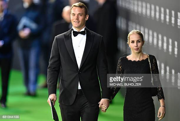 FC Bayern Munich and Germany's goalkeeper Manuel Neuer leaves with his partner Nina Weiss after The Best FIFA Football Awards 2016 ceremony on...
