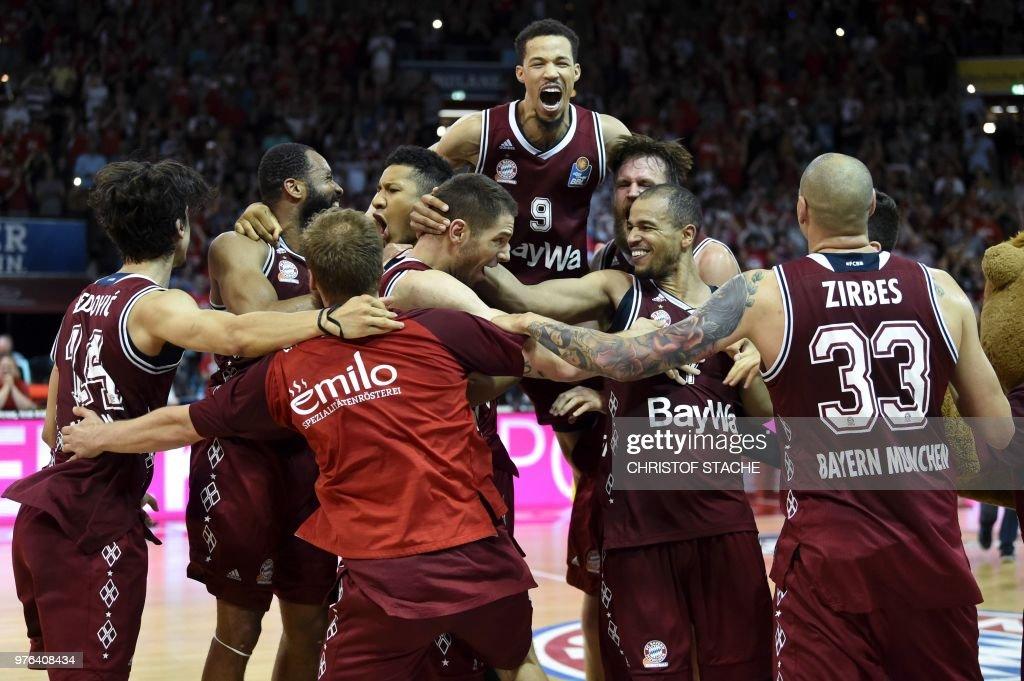 Bayern Munich Basketball players celebrate winning the German Basketball Championship at the Audi Dome in Munich, southern Germany, on June 16, 2018. - Bayern Munich Basketball won the last play off match against Alba Berlin with 106-85.
