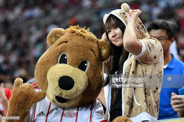 Bayern Munich fan cheers poses with the mascot during the International Champions Cup match between FC Bayern Munich and FC Internazionale at...