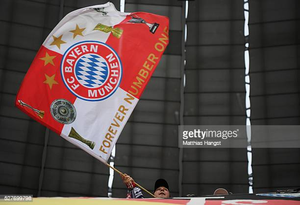Bayern Munich fan waves a flag prior to UEFA Champions League semi final second leg match between FC Bayern Muenchen and Club Atletico de Madrid at...