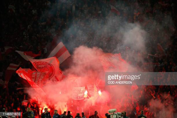 Bayern Munich fans celebrate scoring during the German Cup Final football match RB Leipzig v FC Bayern Munich at the Olympic Stadium in Berlin on May...