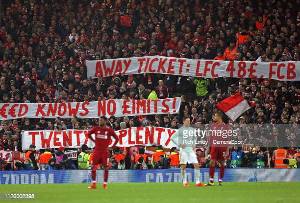 Bayern Munich fans display banners protesting at Liverpool ticket prices during the UEFA Champions League Round of 16 First Leg match between...