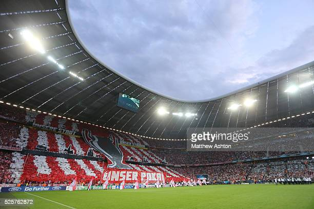 Bayern Munich fans hold up banners at the Allianz Arena stadium