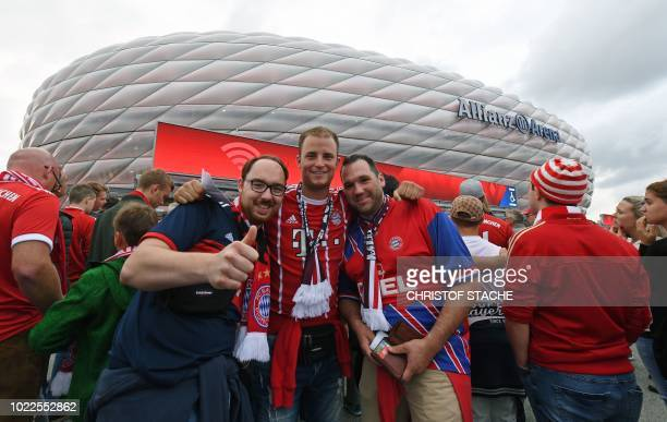 Bayern Munich fans pose for a photo as they arrive prior to the German first division Bundesliga football match FC Bayern Munich v TSG 1899...