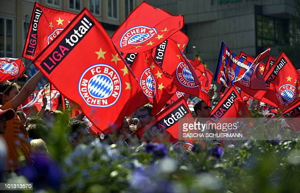 Bayern Munich fans wave flags during a celebration party in the southern German city of Munich on May 23 the day after the UEFA Champions League...