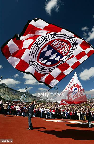 Bayern Munich fans wave flags in celebration of their club winning the league title during the German Bundesliga match between FC Bayern Munich and...