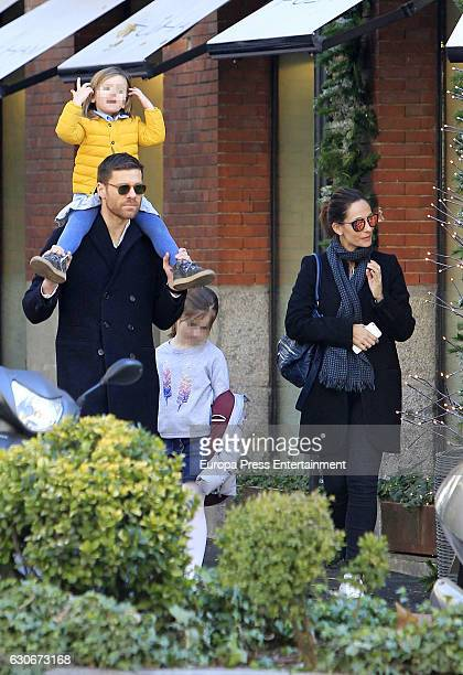Bayern Munich football player Xabi Alonso his wife Nagore Aramburu and their daughters Emma Alonso and Anne Alonso are seen on December 29 2016 in...