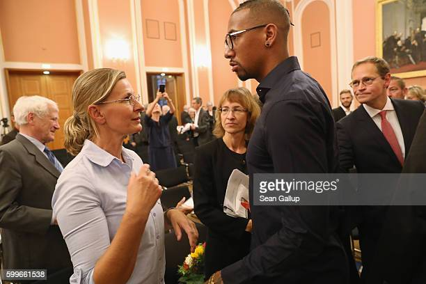 Bayern Munich football star Jerome Boateng chats briefly with his mother Martina Boateng after he received the 2016 Moses Mendelssohn Award as Berlin...