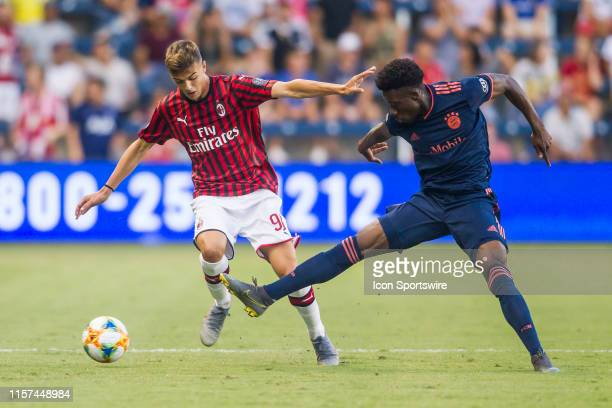 Bayern Munich forward Alphonso Davies disrupts the run of Milan forward Daniel Maldini during the match between FC Bayern and AC Milan on Tuesday...