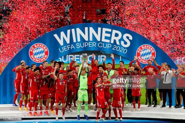 Bayern Munich goalkeeper Manuel Neuer and teammates celebrate with the trophy after winning the UEFA Super Cup football match between FC Bayern...