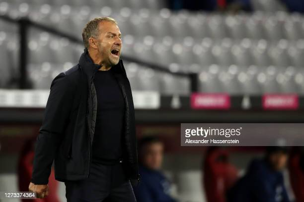 Bayern Munich Head Coach / Manager, Hans-Dieter Flick gives his players instructions from the sidelines during the Bundesliga match between FC Bayern...