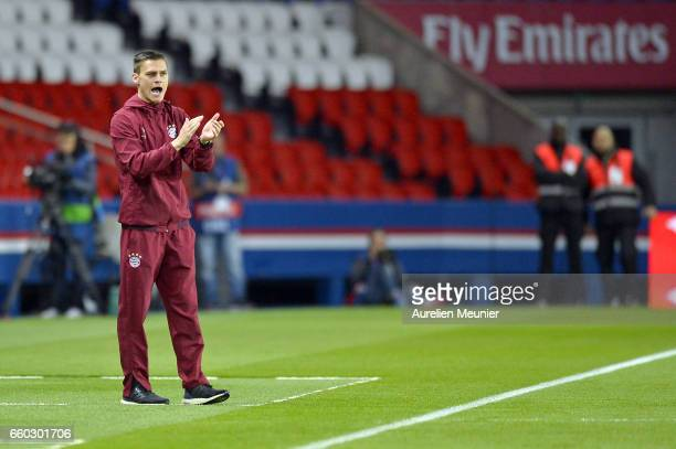 Bayern Munich Head Coach Thomas Worle reacts during the Champions League match between Paris Saint Germain and Bayern Munich at Parc des Princes on...