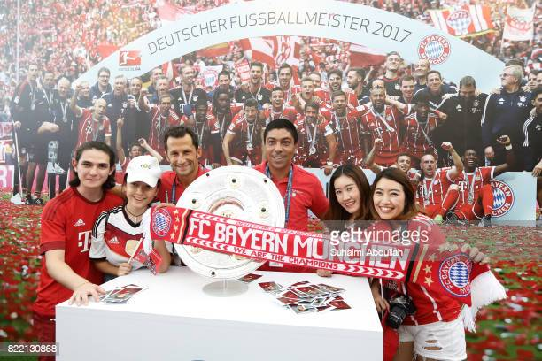 Bayern Munich legend Hasan Salihamidzic and Giovane Elber pose for a photo with fans during the ICC Singapore Fan Zone at OCBC Square on July 25 2017...