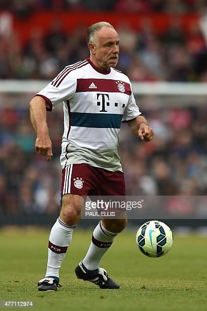 Bayern Munich legend Michael Rummenigge controls the ball during the friendly football match between Manchester United's Legends and Bayern Munich...