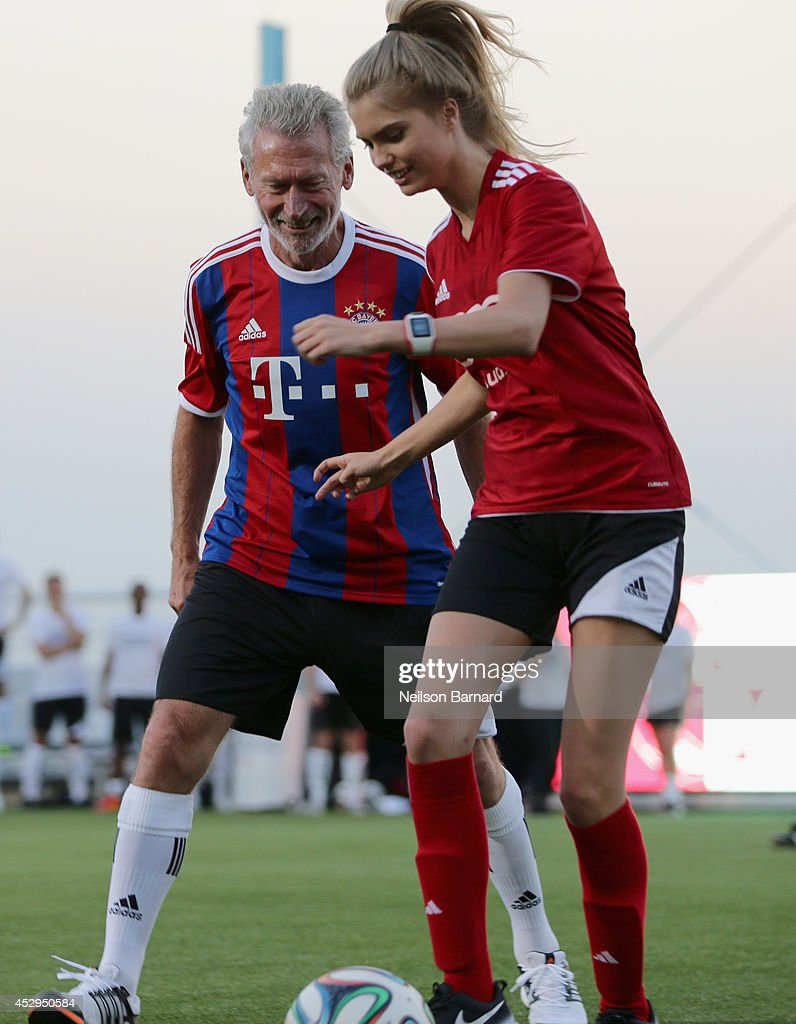 FC Bayern Munich legend Paul Breitner and Alexandria Morgan at the Audi Soccer Pick-Up Game at Pier 2 at Brooklyn Bridge Park on July 30, 2014 in Brooklyn borough of New York City.