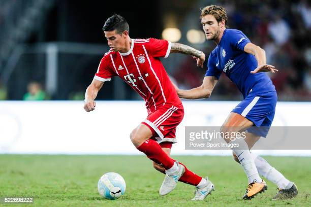 Bayern Munich Midfielder James Rodrguez fights for the ball with Chelsea Defender Marcos Alonso during the International Champions Cup match between...