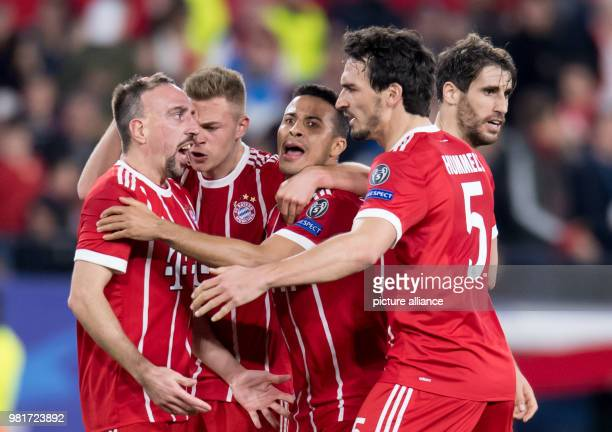 Bayern Munich players celebrate after scoring their first goal in a 21 win at Sevilla in the first leg of the Champions League quarterfinal tie on...