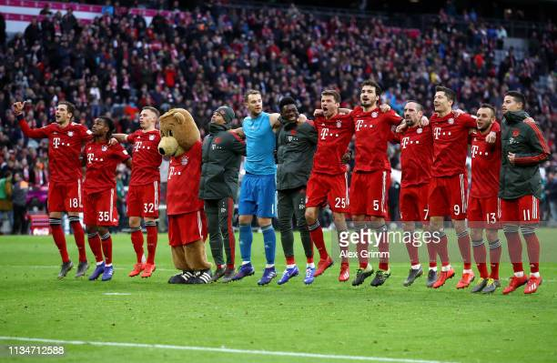 Bayern Munich players celebrate after the Bundesliga match between FC Bayern Muenchen and VfL Wolfsburg at Allianz Arena on March 09 2019 in Munich...