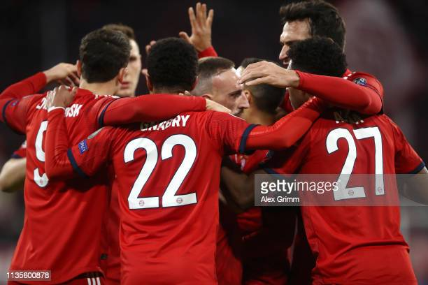 Bayern Munich players celebrate as Joel Matip of Liverpool scores their first goal with an own goal during the UEFA Champions League Round of 16...