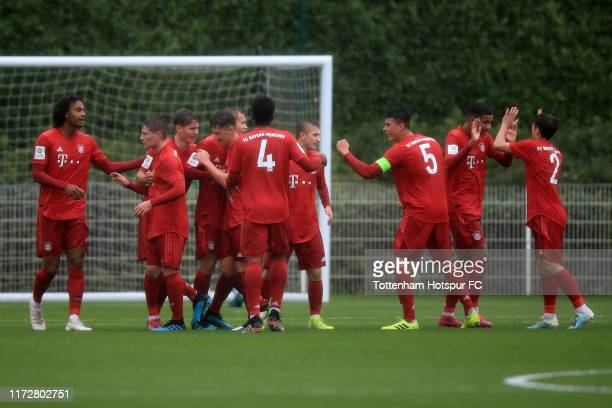Bayern Munich players celebrate their 1st goal during the UEFA Youth League Group B match between Tottenham Hotspur and Bayern Munich on October 1,...