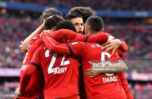 Bayern Munich players celebrate their team's second goal during the Bundesliga match between FC Bayern Muenchen and VfL Wolfsburg at Allianz Arena on...