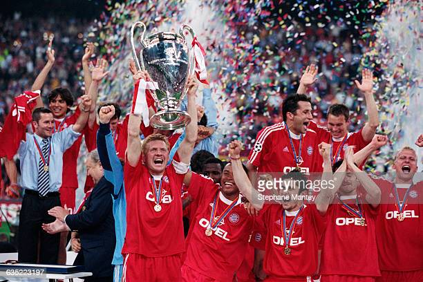 Bayern Munich players celebrate their victory after the 20002001 Champions League final Stefan Effenberg holds the trophy