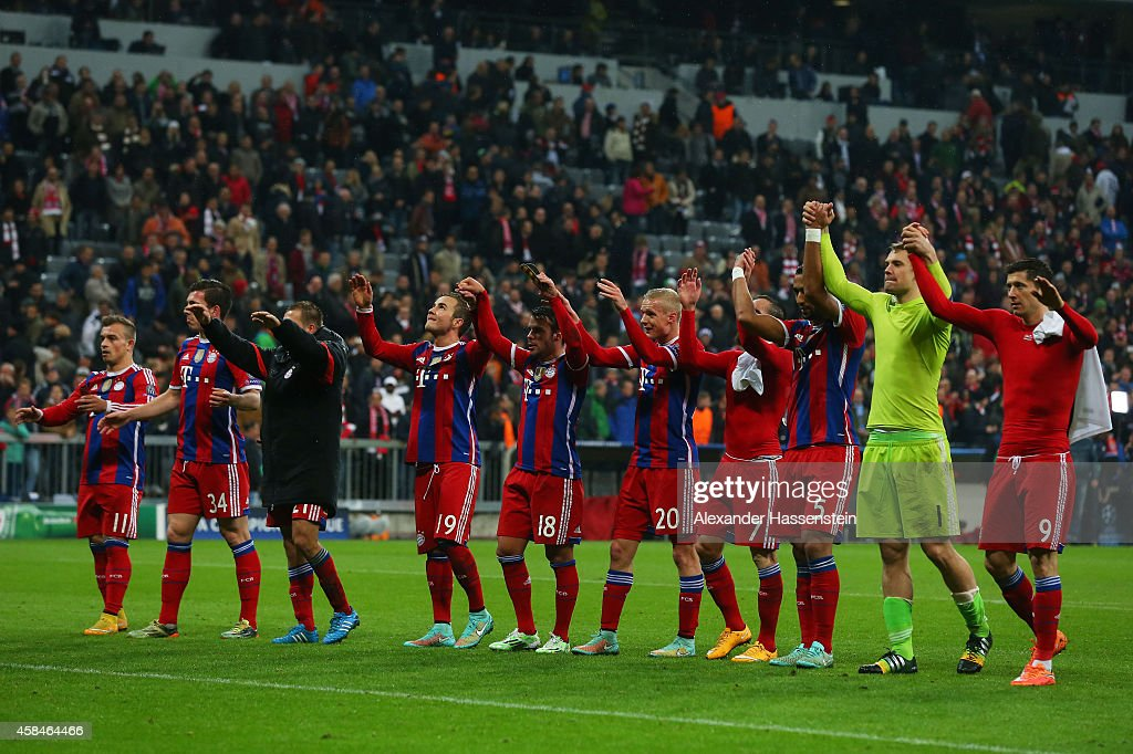 Bayern Munich players celebrate victory after the UEFA Champions League Group E match between FC Bayern Munchen and AS Roma at Allianz Arena on November 5, 2014 in Munich, Germany.