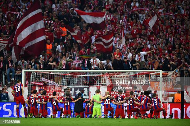 Bayern Munich players celebrate victory in front of the fans after the UEFA Champions League Quarter Final Second Leg match between FC Bayern...