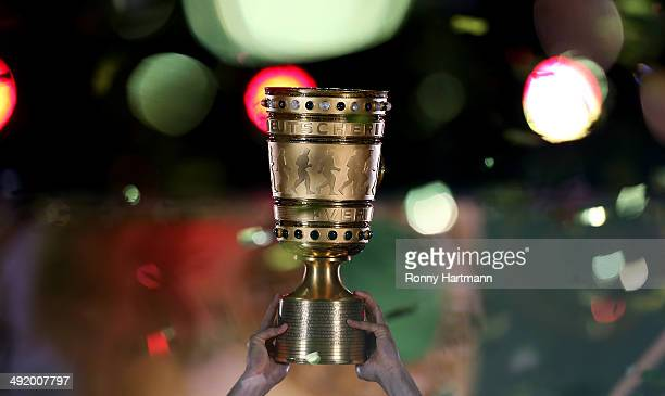 Bayern Munich players celebrate with the trophy after the DFB Cup final match 2014 between Borussia Dortmund and Bayern Muenchen at Olympiastadion on...