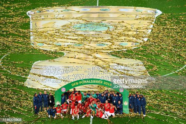 Bayern Munich players celebrate with the trophy after winning the German Cup Final football match RB Leipzig v FC Bayern Munich at the Olympic...