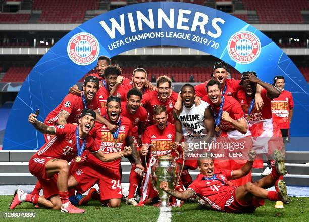 Bayern Munich players celebrate with the UEFA Champions League Trophy following their team's victory in the UEFA Champions League Final match between...