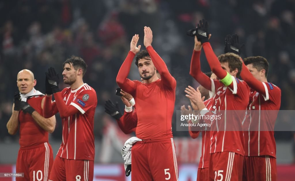Bayern Munich players, in the center Mats Hummels, celebrate their victory after the UEFA Champions League Round of 16 soccer match between FC Bayern Munich and Besiktas at the Allianz Arena in Munich, Germany, on February 20, 2018.