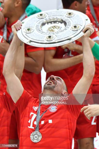 Bayern Munich players including Bayern Munich's French midfielder Franck Ribery celebrate with the trophy after the German First division Bundesliga...