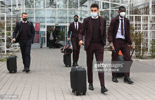 Bayern Munich players leave the airport upon arrival in Munich, southern Germany, on April 14, 2021 as the team returns following their UEFA...